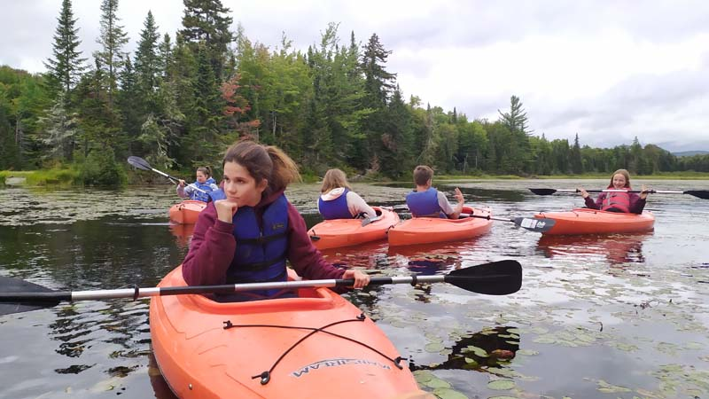Photo of students canoeing in the Adirondacks.