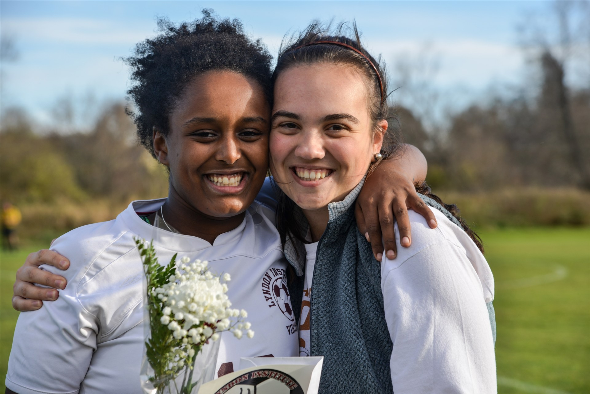 A portrait of two female students at a Senior Day celebration.