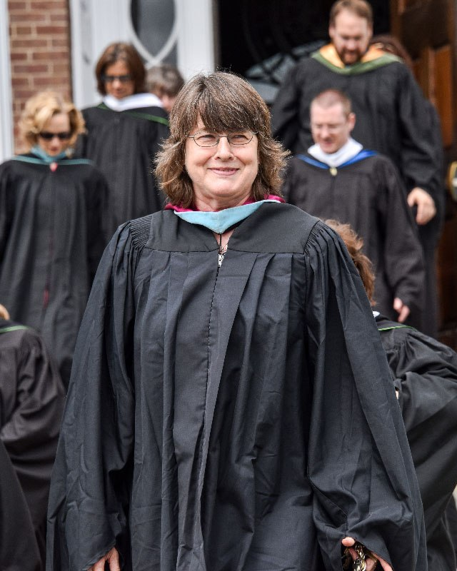 Head of School Twila Perry in front of the Main Building during Commencement.